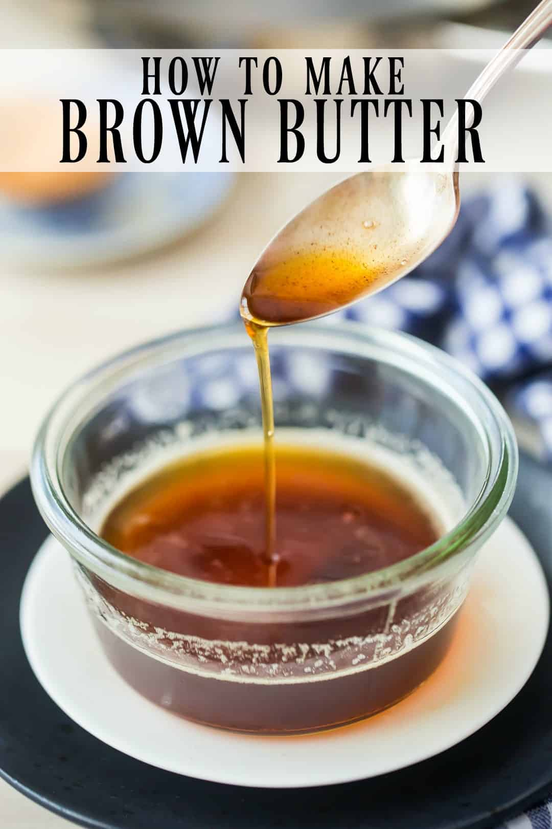 "Brown butter sauce being drizzled from a spoon into a glass bowl, with a text overlay above reading ""How to Make Brown Butter."""