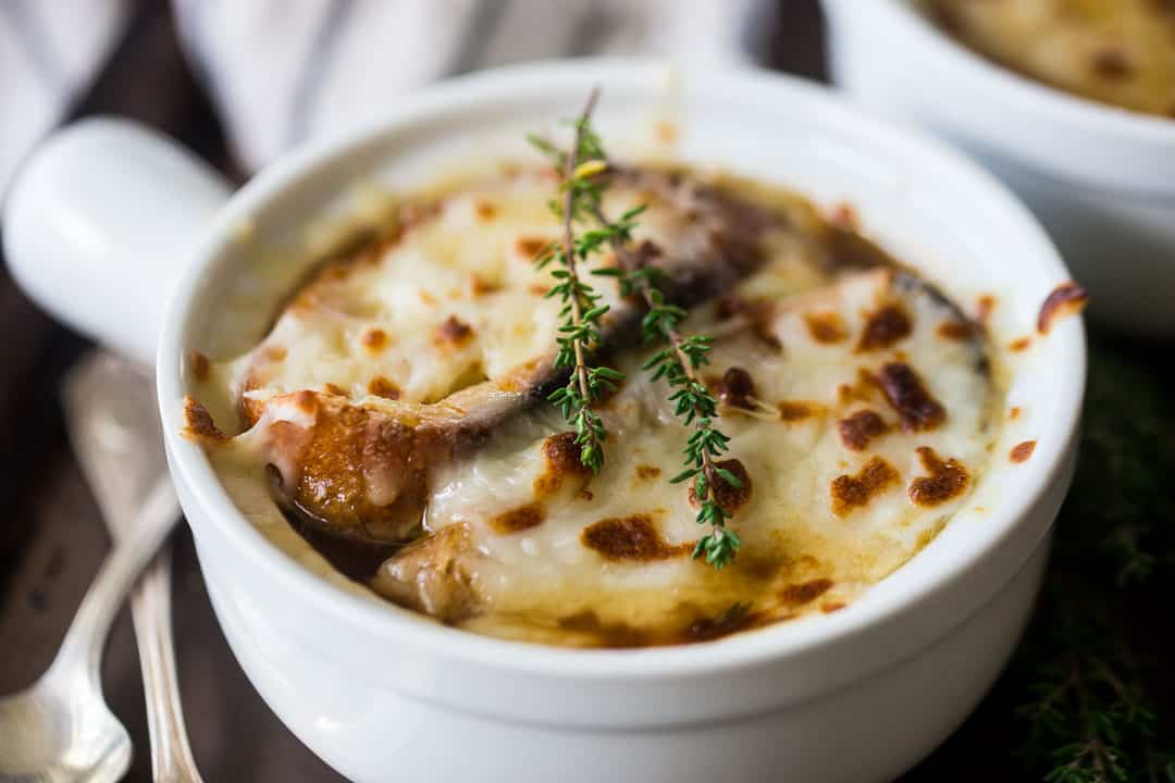 Close up image of a bowl of crock pot French onion soup.