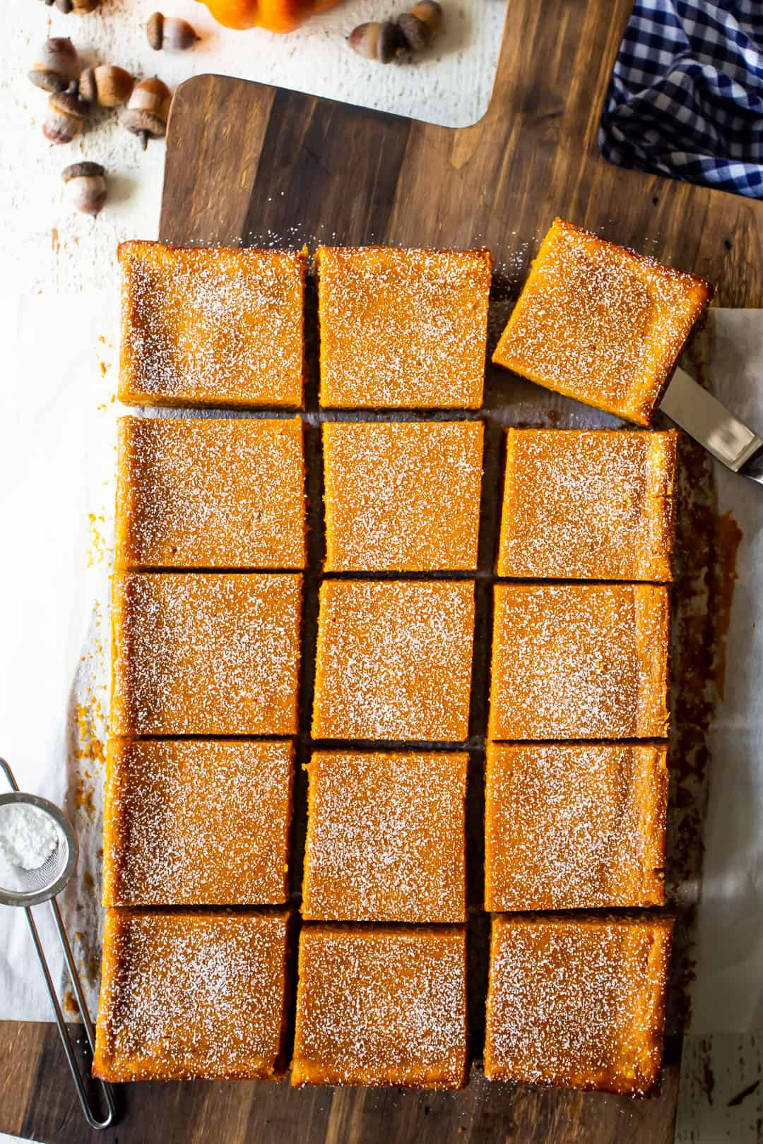 Overhead image of Paula Deen pumpkin gooey butter cake bars made from scratch.