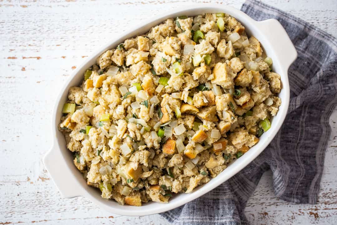 Unbaked Thanksgiving stuffing in a casserole dish.