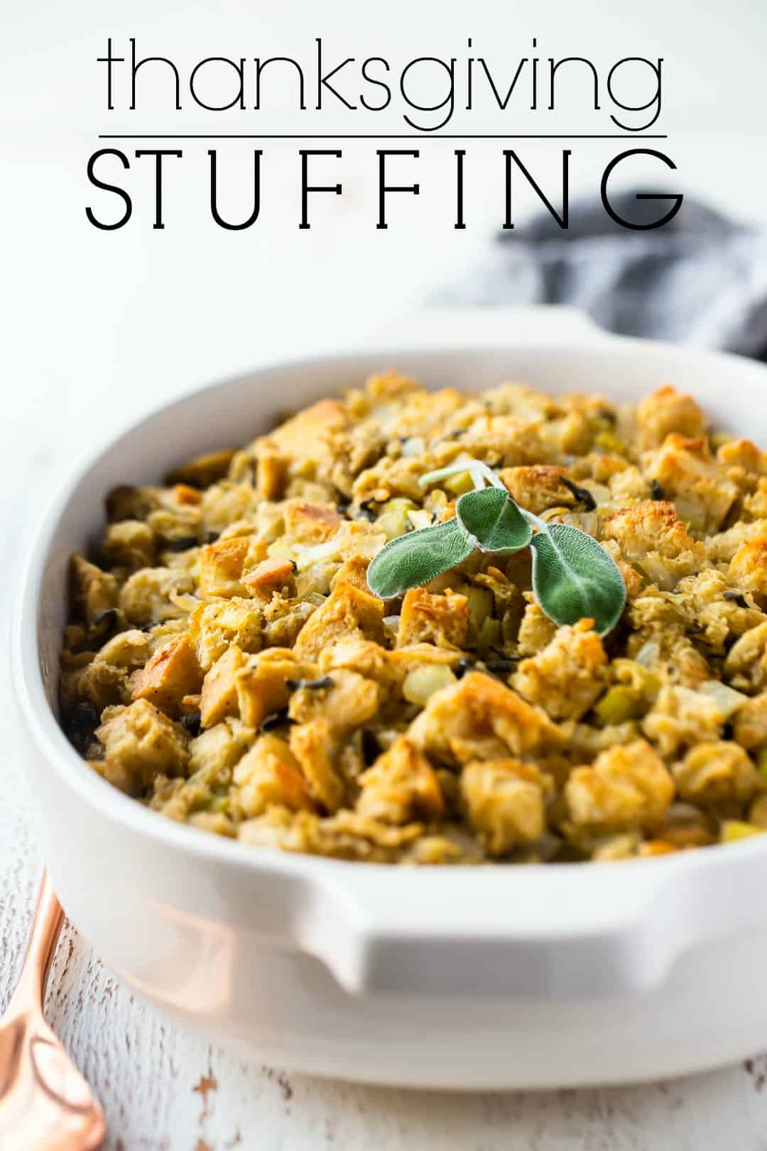 "Thanksgiving stuffing in a white casserole dish with a text overlay above reading ""Thanksgiving Stuffing."""