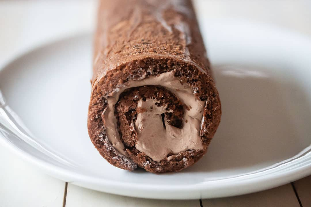 Yule log cake rolled with chocolate whipped cream.