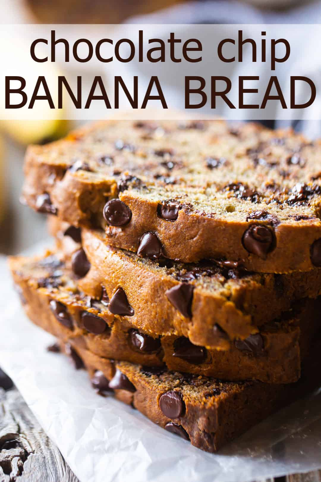 "Chocolate chip banana bread, prepared, sliced, and stacked on a wood table with a text overlay that reads ""Chocolate Chip Banana Bread."""