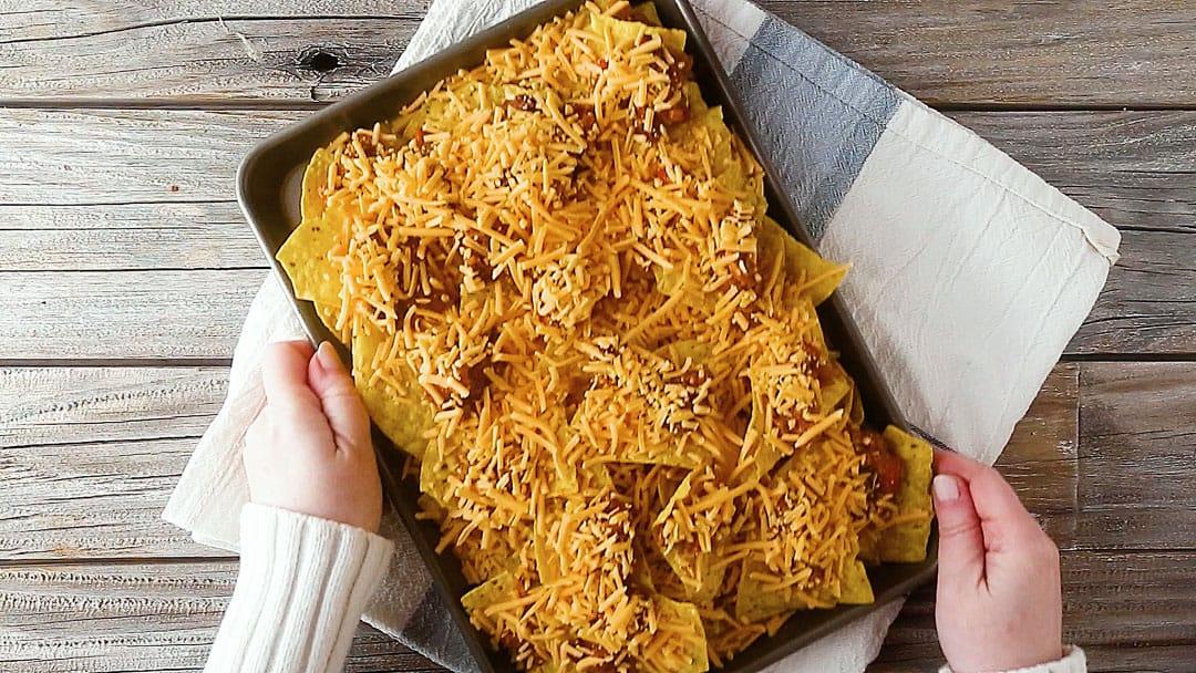 Sheet pan nachos recipe, ready to go into the oven.