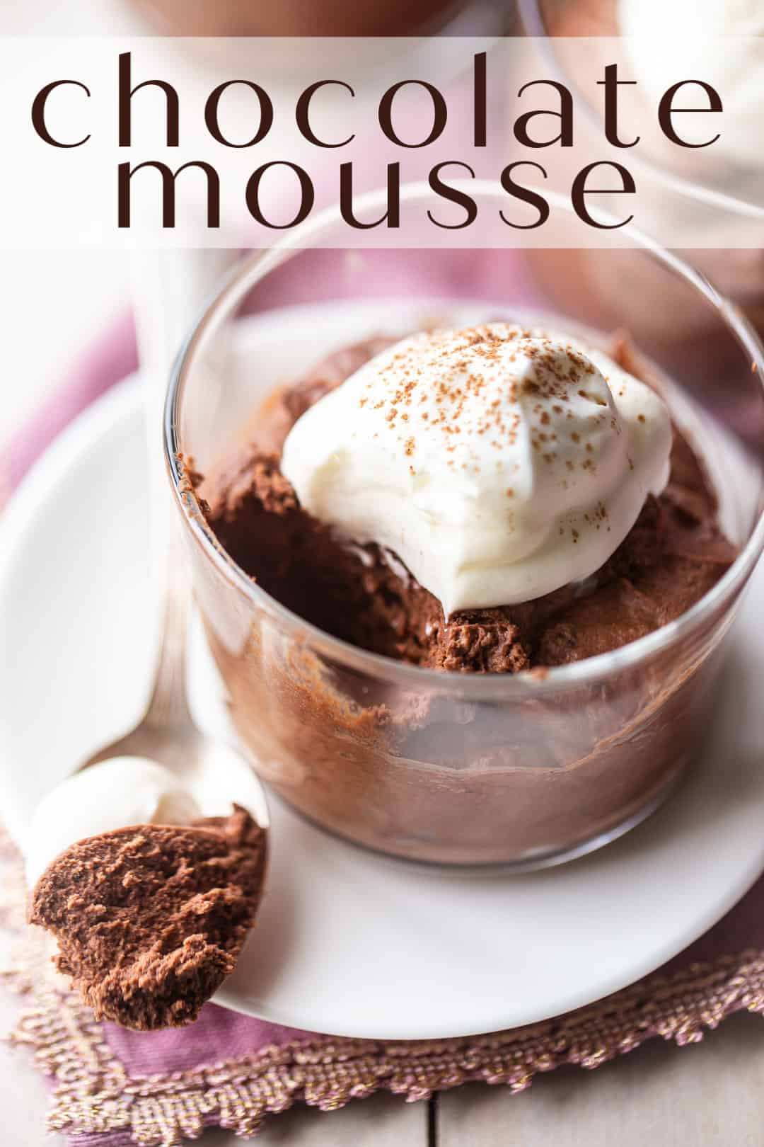 "Chocolate mousse recipe, prepared and served in a small glass bowl, with whipped cream and a text overlay above that reads ""Chocolate Mousse."""
