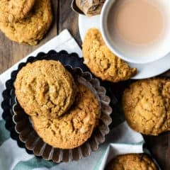 Irish oat cookies in a fluted pan with a cup of tea.