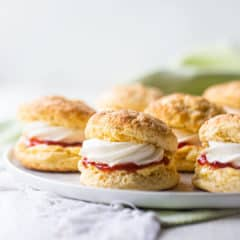 Irish scones on a white platter with a pale green napkin.