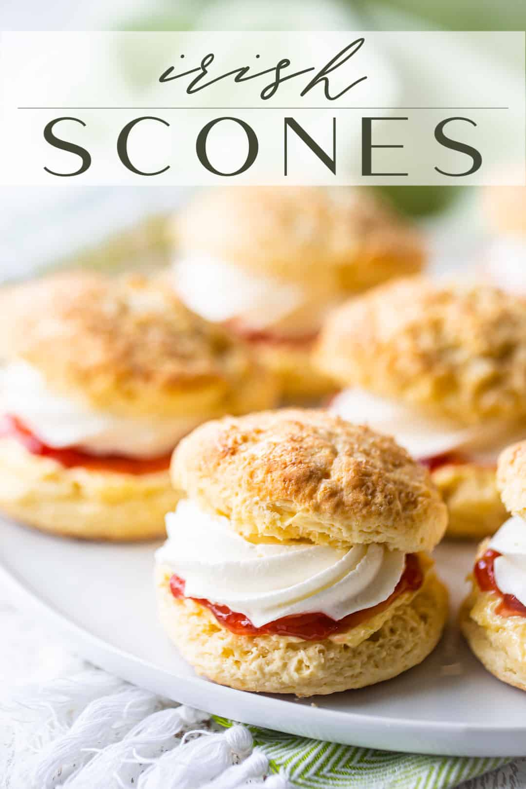 "Irish scone recipe, prepared and served on a white platter, with a text overlay above that reads ""Irish Scones."""