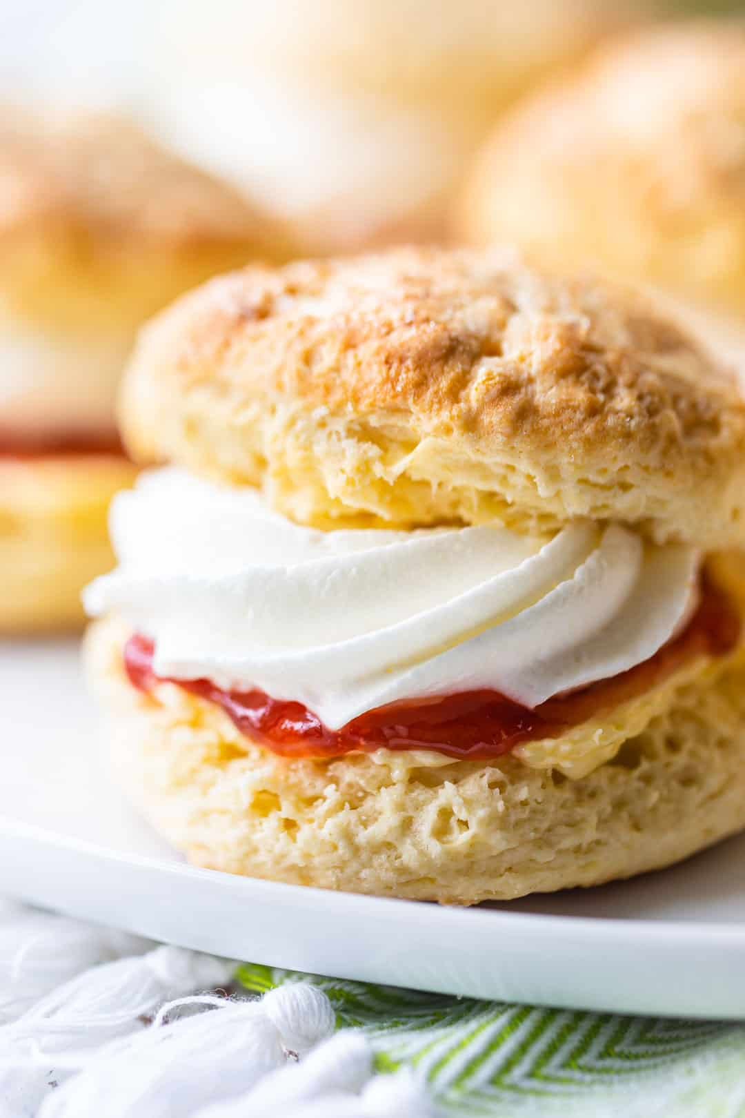 Scones recipe, easy to make and served with butter, strawberry jam, and whipped cream.