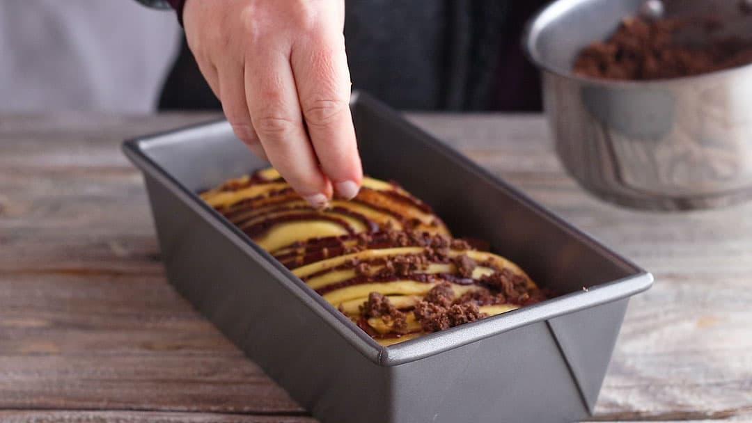 Topping chocolate babka with streusel.