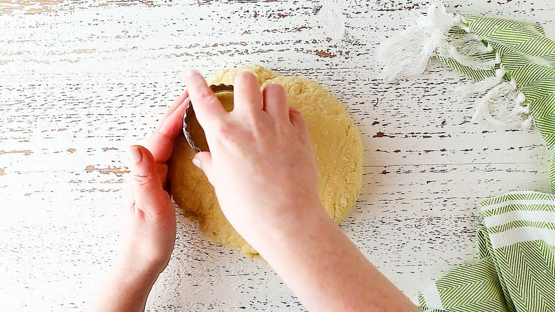 Cutting Irish scones with a 2 1/2-inch round cutter.
