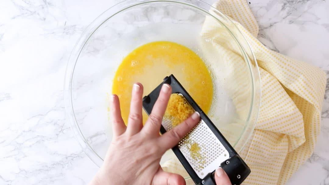 Zesting a lemon with a microplane.