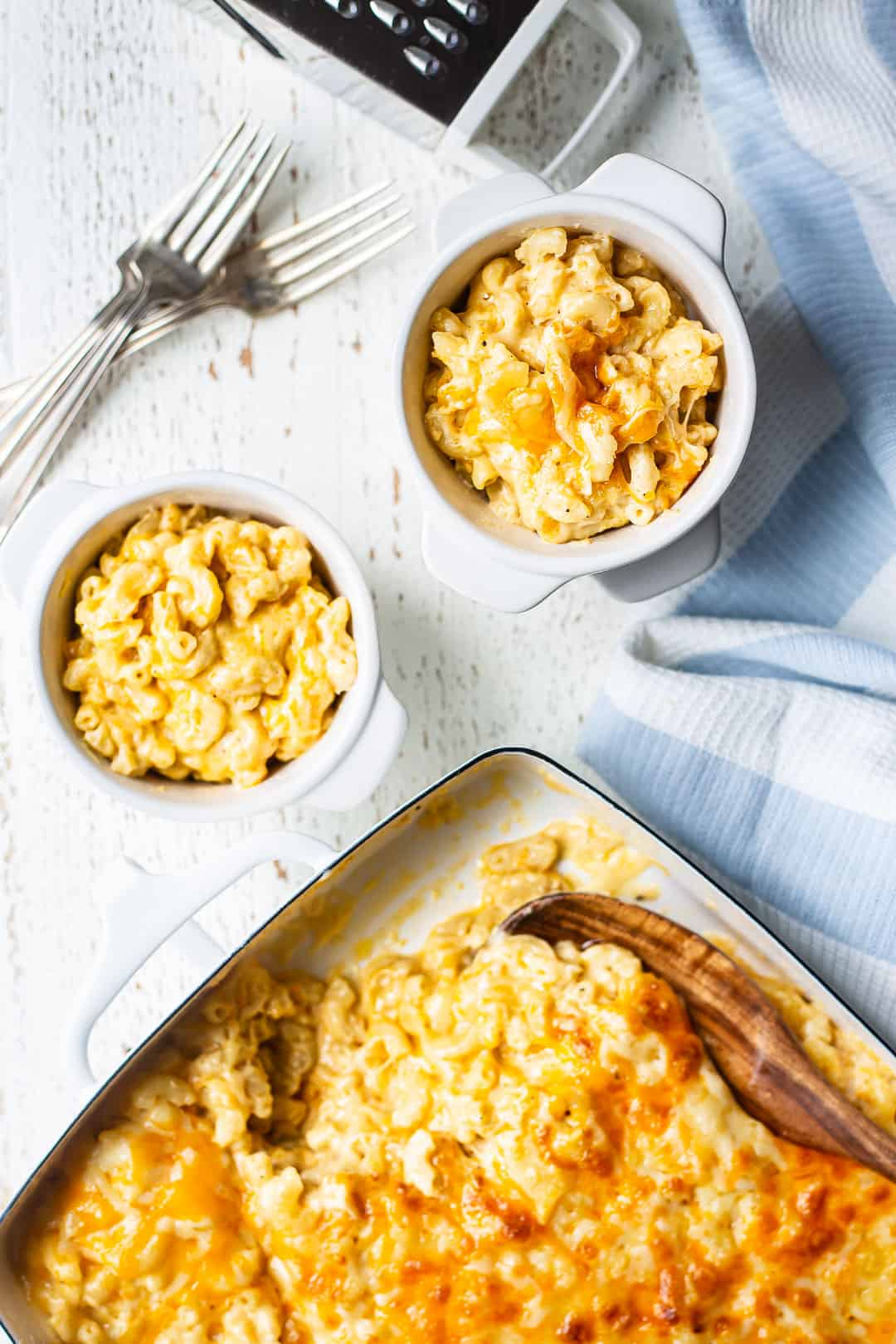 Overhead image of baked macaroni and cheese recipes, spooned from the baking dish into individual bowls.