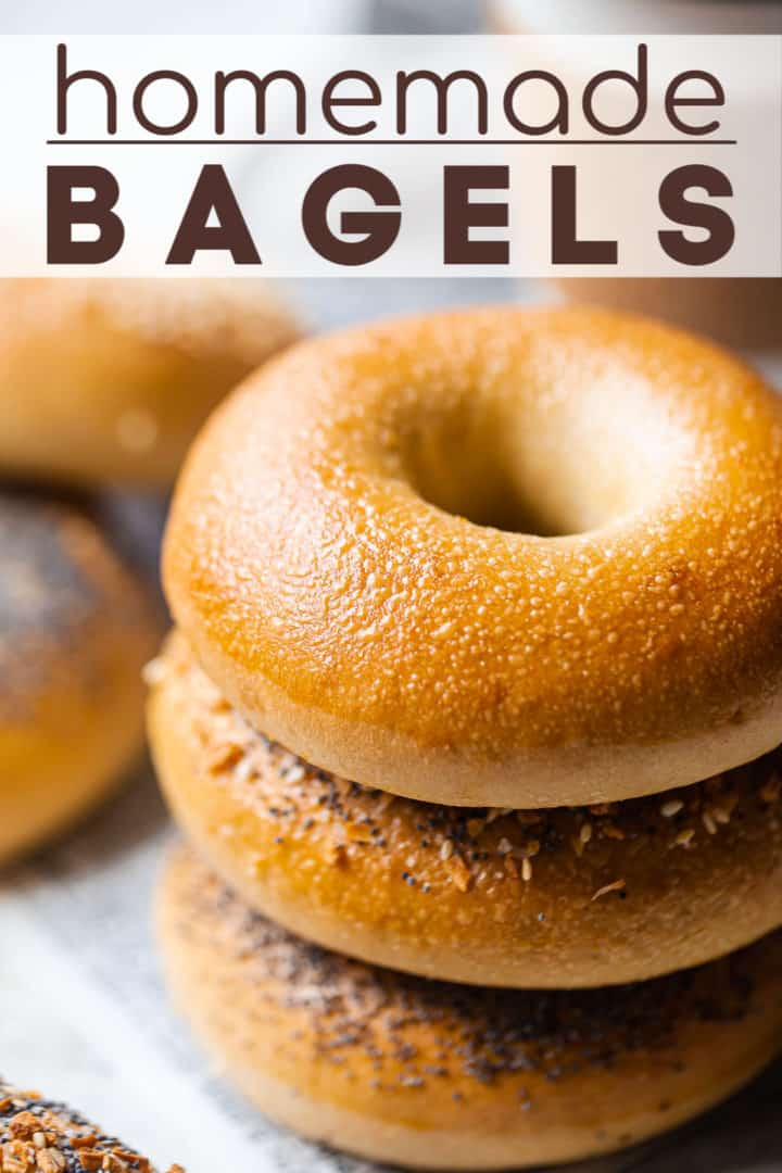 """Close up image of a stack of poppy seed, everything, sesame, and plain bagels, with a text overlay above reading """"Homemade Bagels."""""""