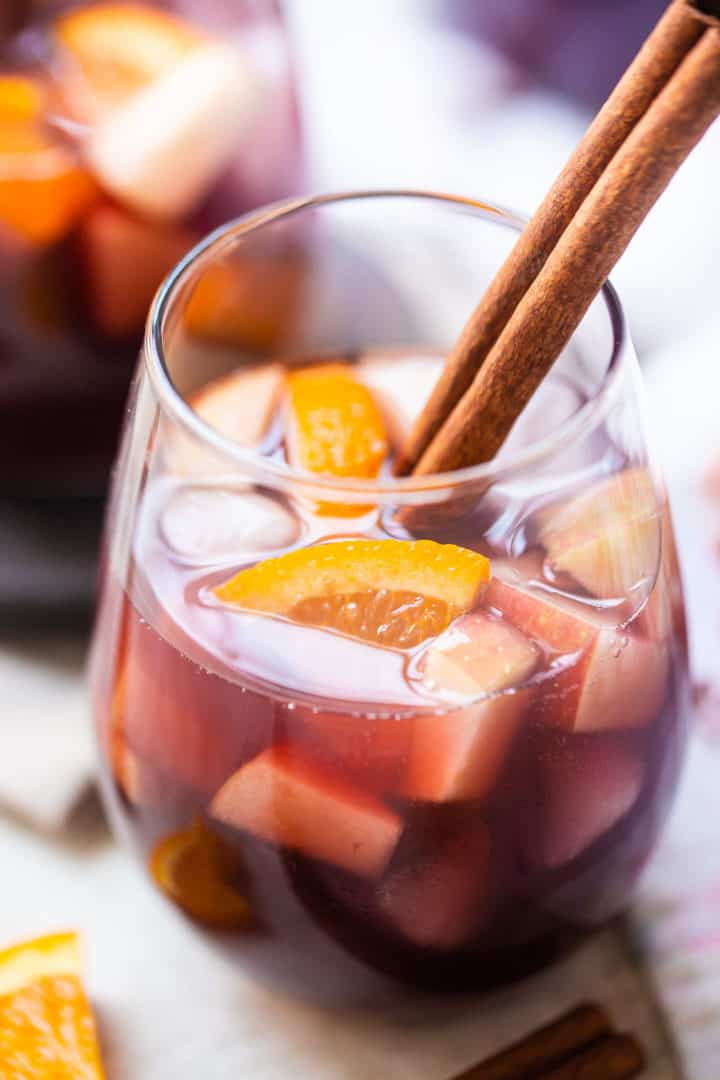 How to make sangria served in wine glasses with fresh fruit and cinnamon.