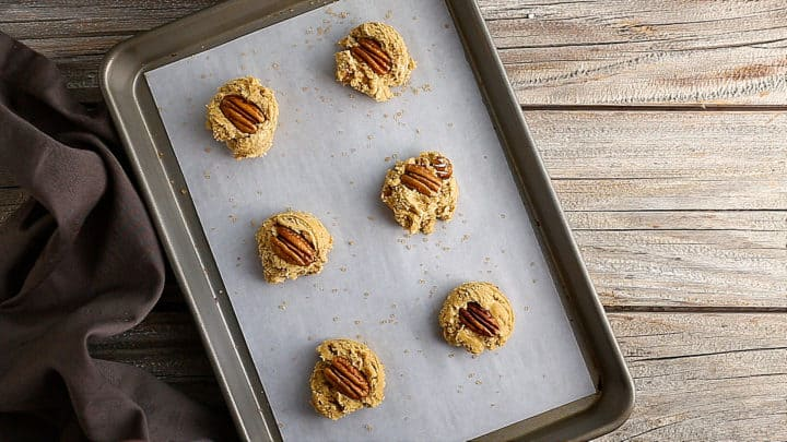 Unbaked butter pecan cookies on a tray.