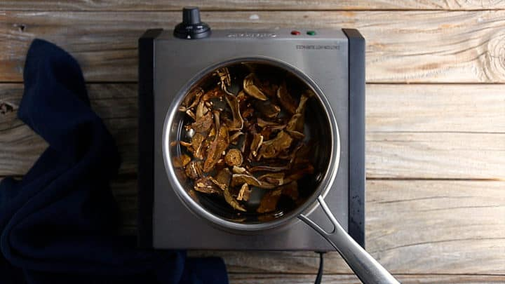 Soaking dried mushrooms in a pot of simmering water.