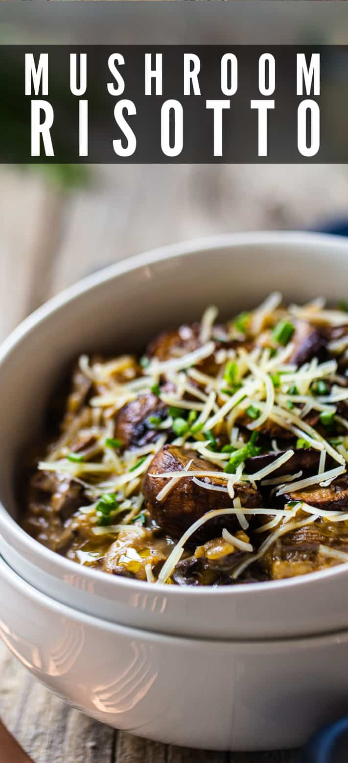 Mushroom risotto garnished with fresh herbs.