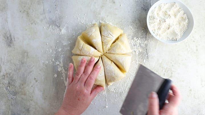 Dividing dough into 8 equal portions.