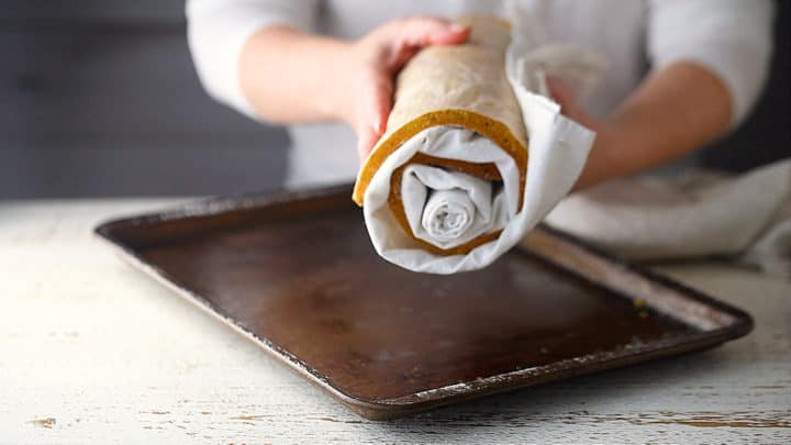 Pumpkin cake rolled in a cylinder to cool.