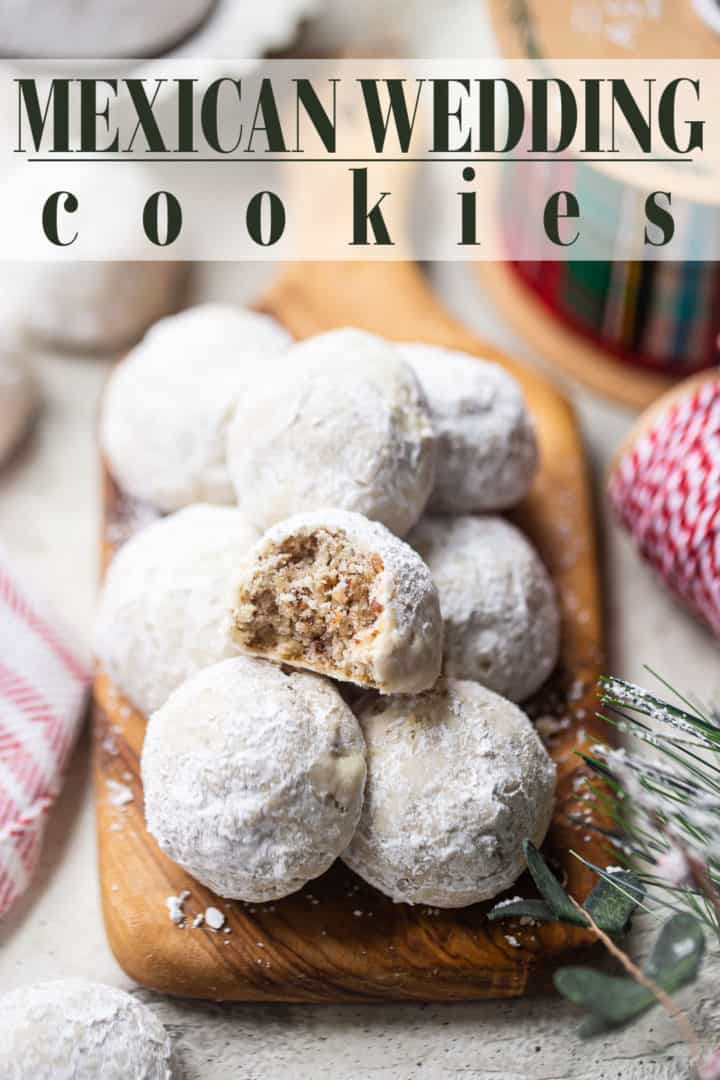 """Snowball cookies on a wooden serving board, with a text overlay that reads """"Mexican Wedding Cookies."""""""