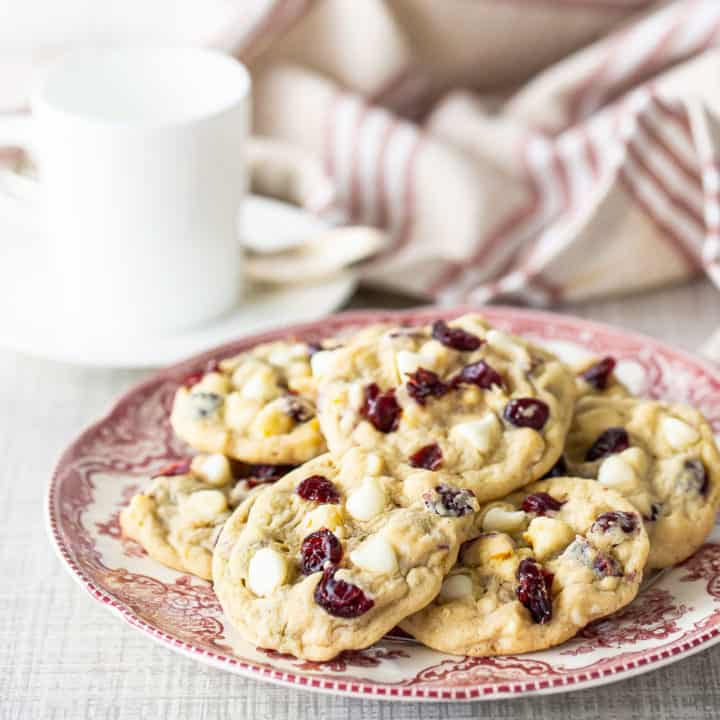 Oatmeal cranberry cookies on a vintage red and white plate.