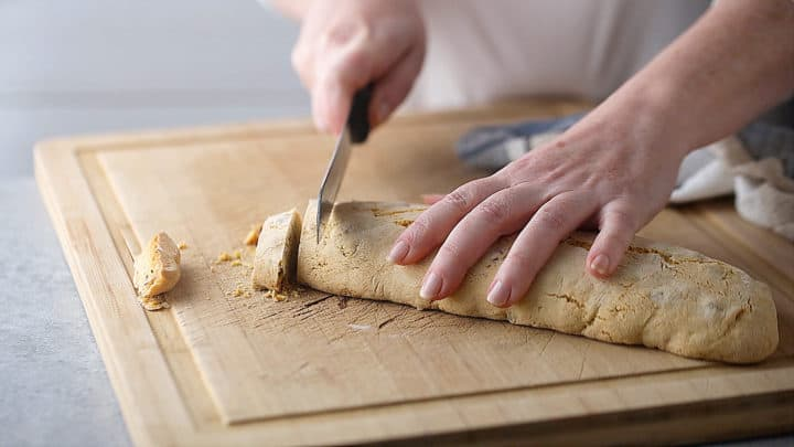 Cutting loaves into 1/2-inch thick slices.