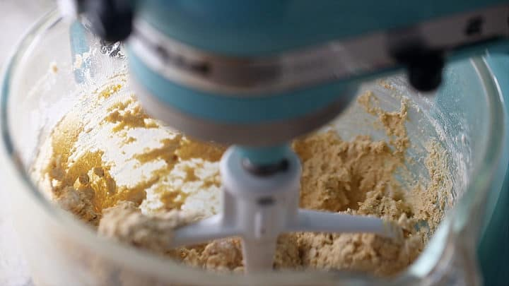 Mixing oatmeal cranberry cookie dough in a stand mixer.