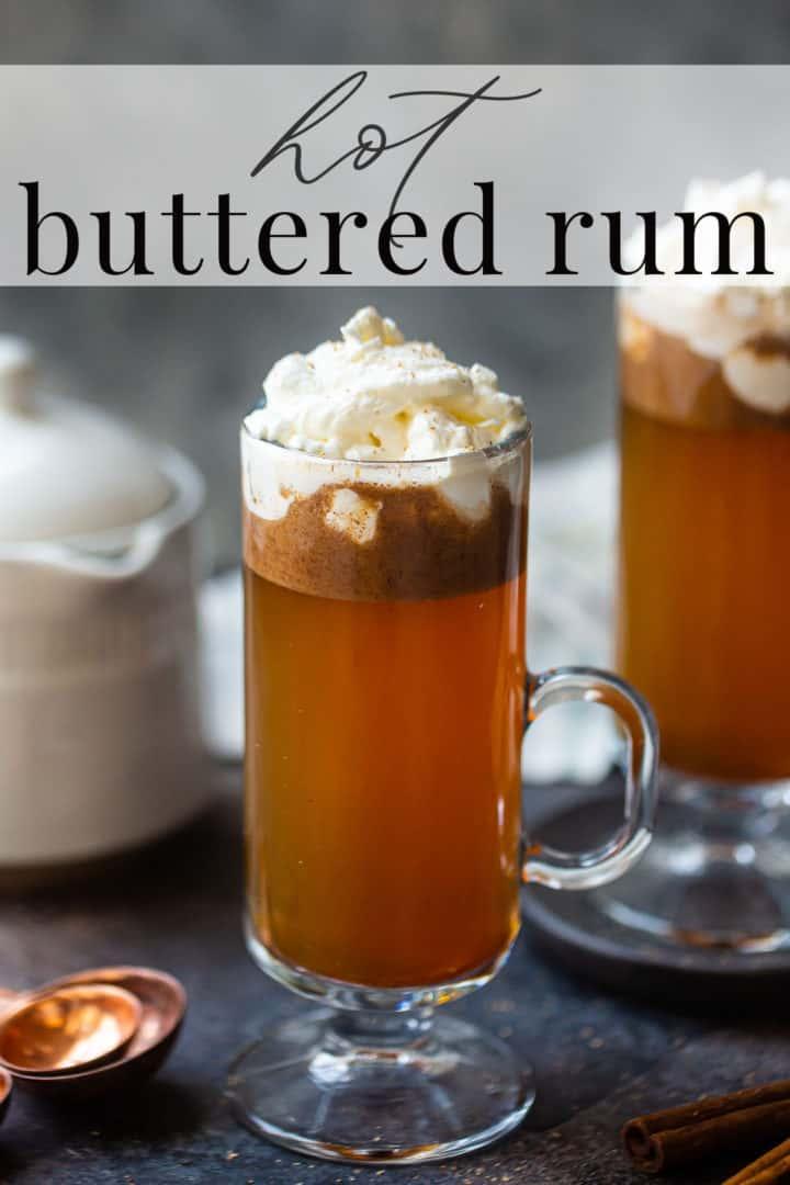 Hot buttered rum recipe, prepared and served in tall glass mugs.
