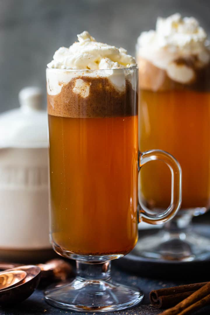 Hot buttered rum ingredients mixed in a tall glass mug.