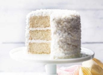coconut cake on white cake stand