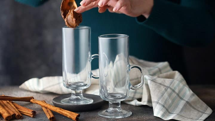 Placing batter in the bottom of a serving mug.
