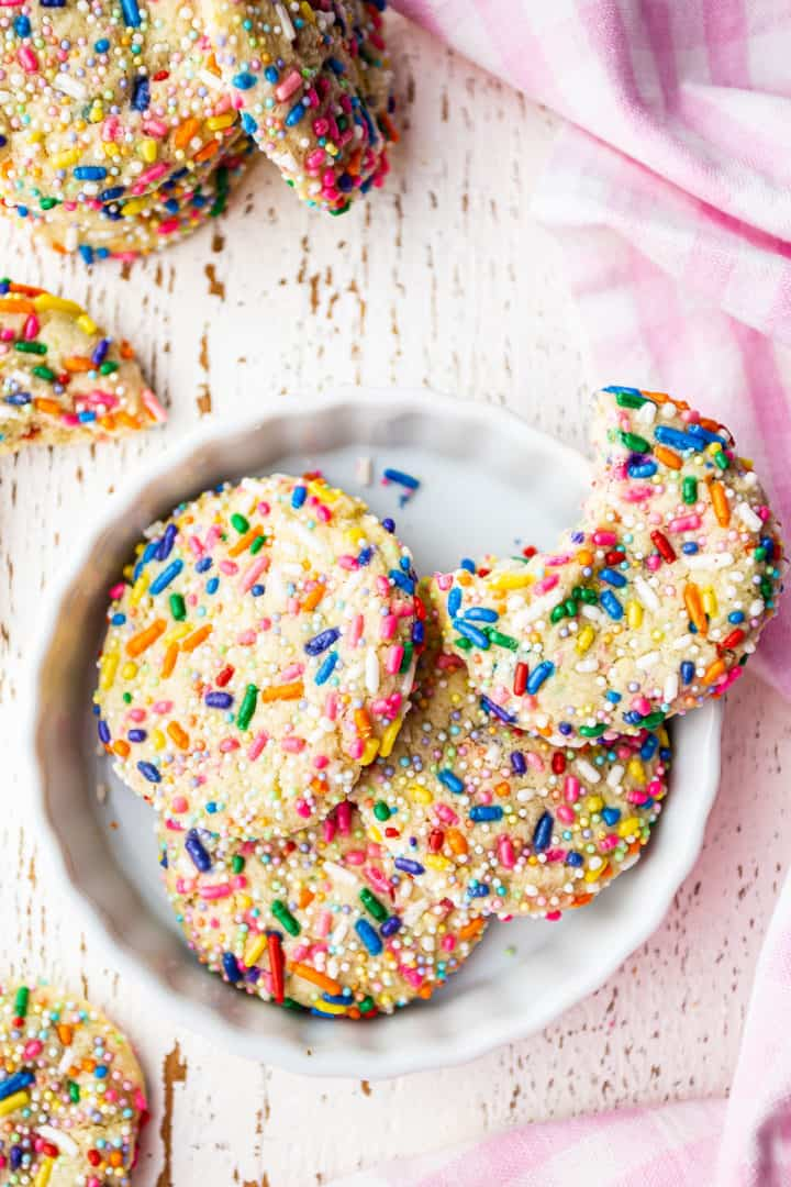 Funfetti cookie recipe, baked and displayed on a white background with a pink checked cloth.