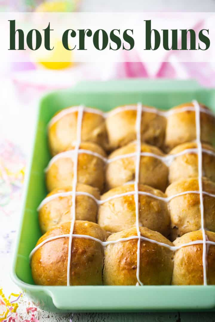 """Hot cross buns recipe baked in a green dish, with a text overlay above that reads """"Hot Cross Buns."""""""