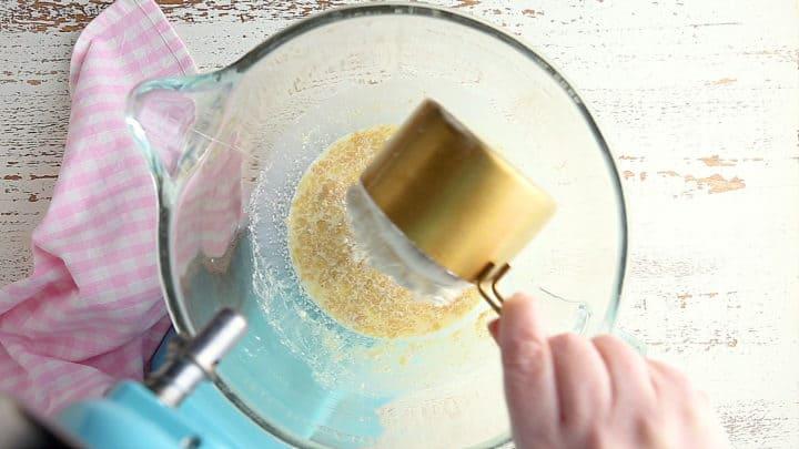 Adding flour to yeast mixture.