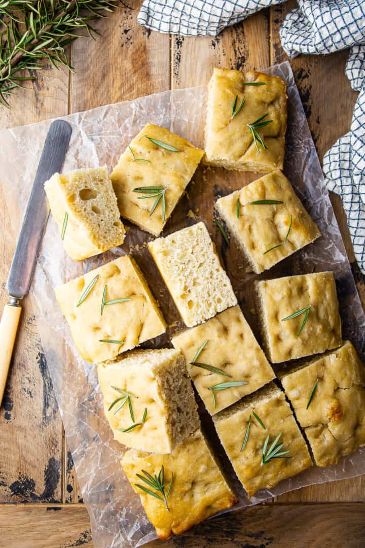 Focaccia recipe baked in a tray and sliced into squares.