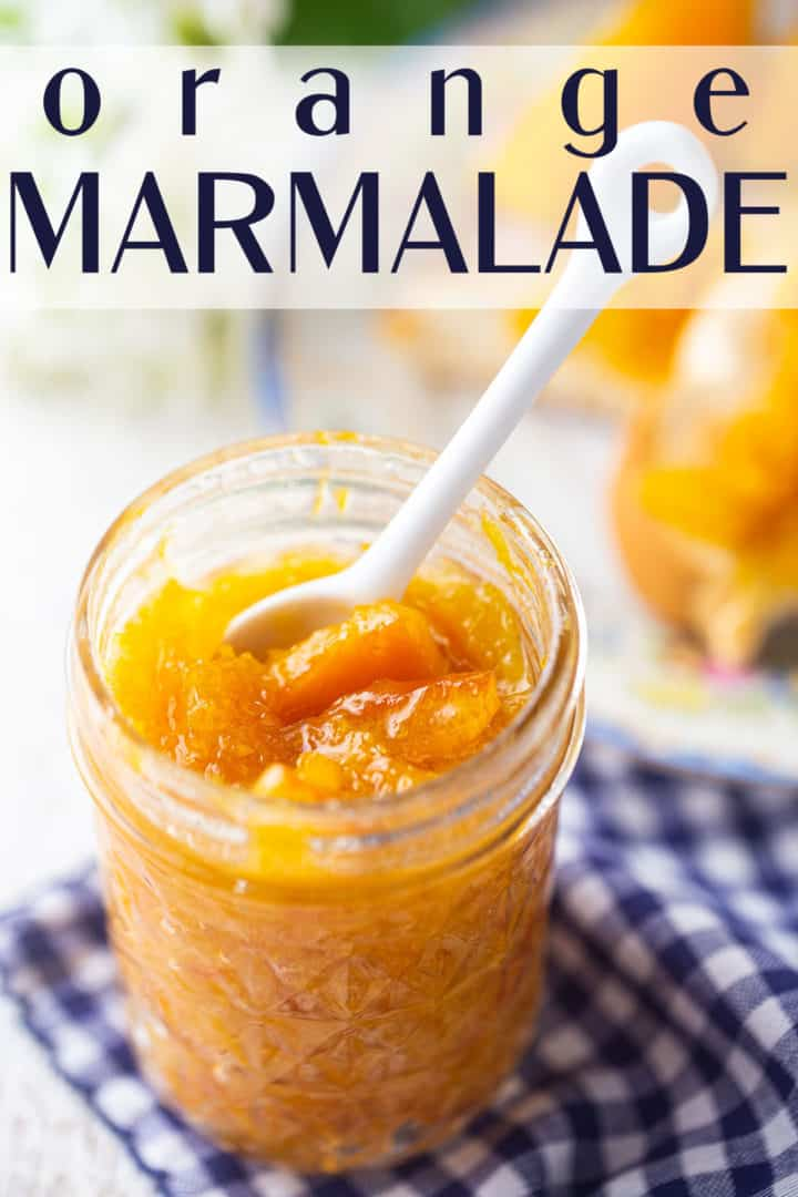 """Orange marmalade in a glass jar on a checkered cloth, with a text overlay that reads """"Orange Marmalade."""""""