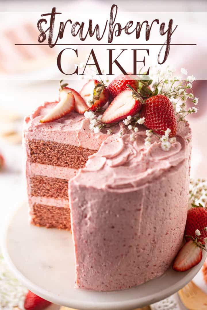 """Strawberry cake recipe, prepared and served on a marble pedestal, with a text overlay that reads """"Strawberry Cake."""""""